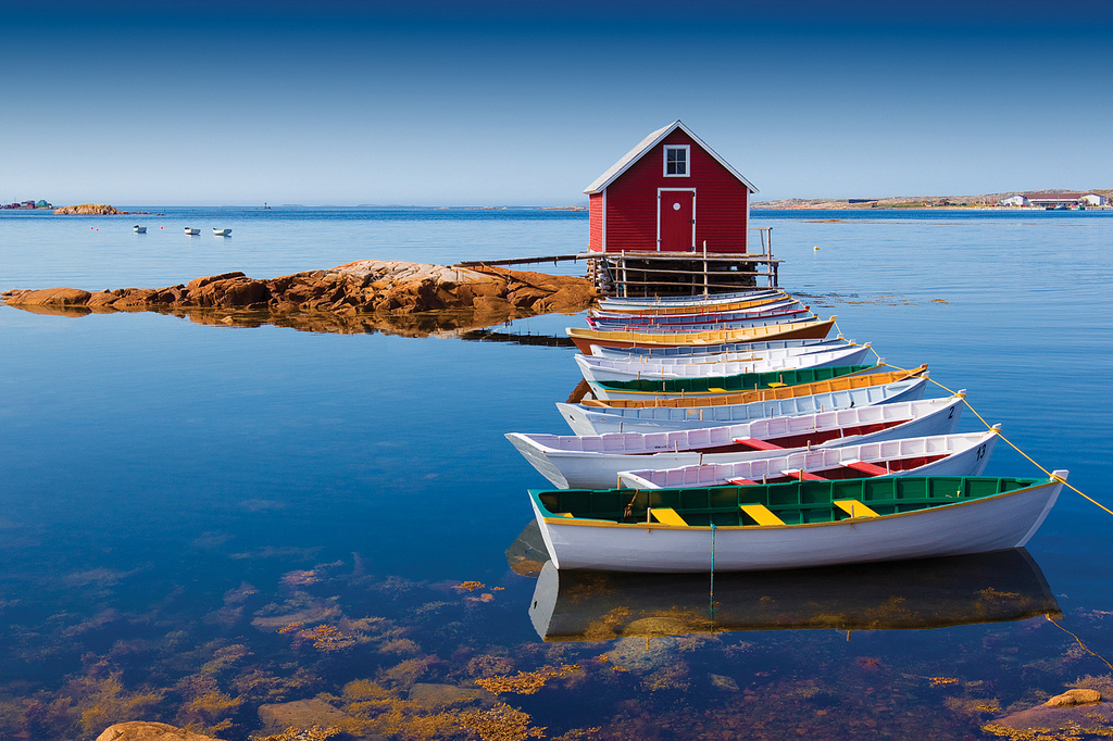 Peaceful lake with colourful boats and a nice little hut your retreat for travel as therapy