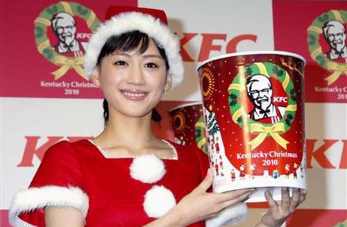 Japanese Christmas girl with KFC bucket intriguing traditions