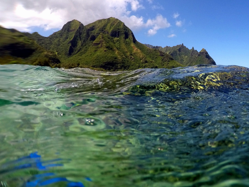 Crystal clear water and green Hawaiian hills the perfect getaway to warmer climes