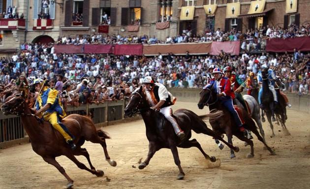 Palio di Siena festival of Il Palio bareback horse riders in Italy