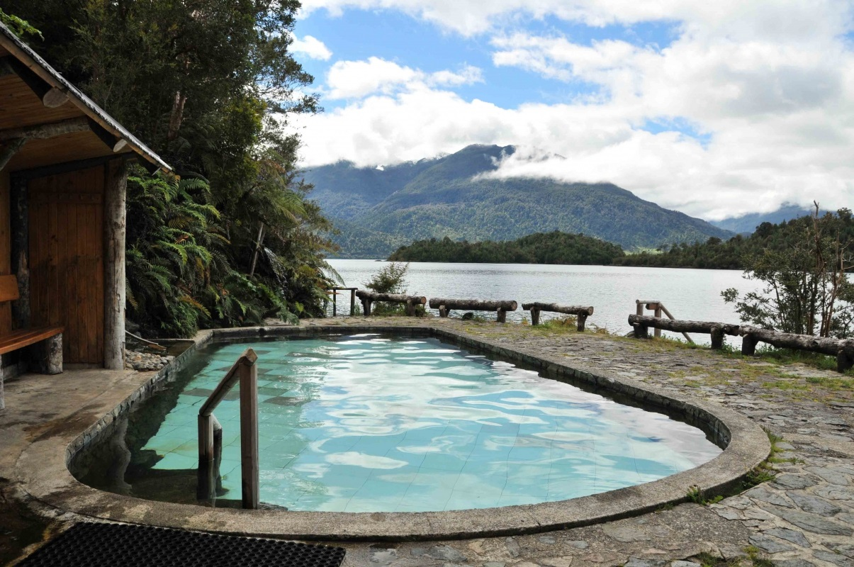 Termas de Puyuhuapi hot geothermal spa relaxing with a view on Chilean mountains
