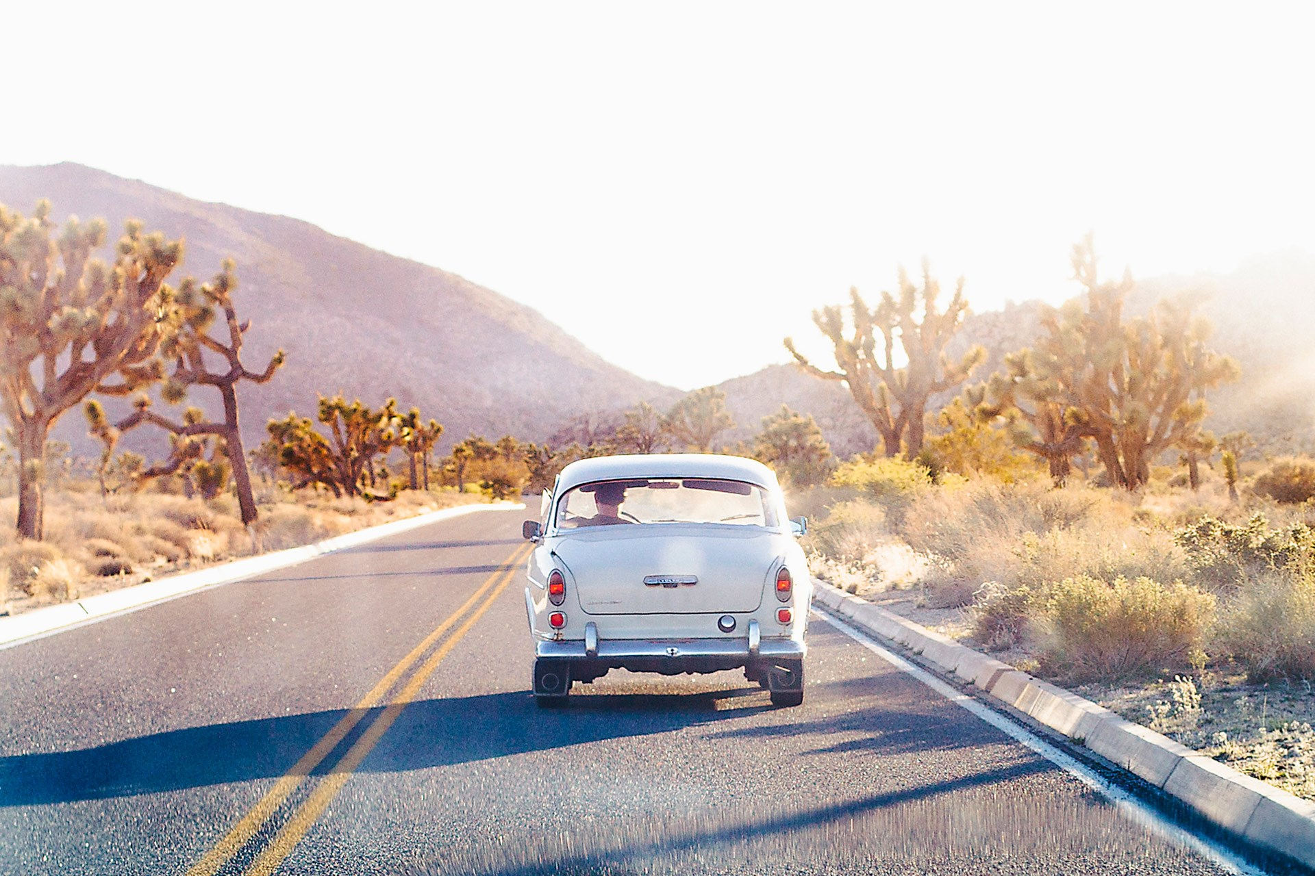 Solo travel roadtrip california empty road vintage car sun and freedom truly bespoke