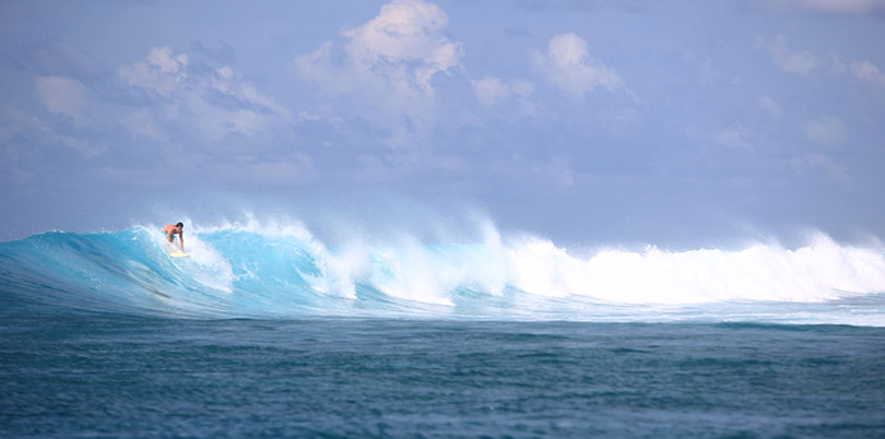 Surfing in the Maldives on your exquisitely crafted journey