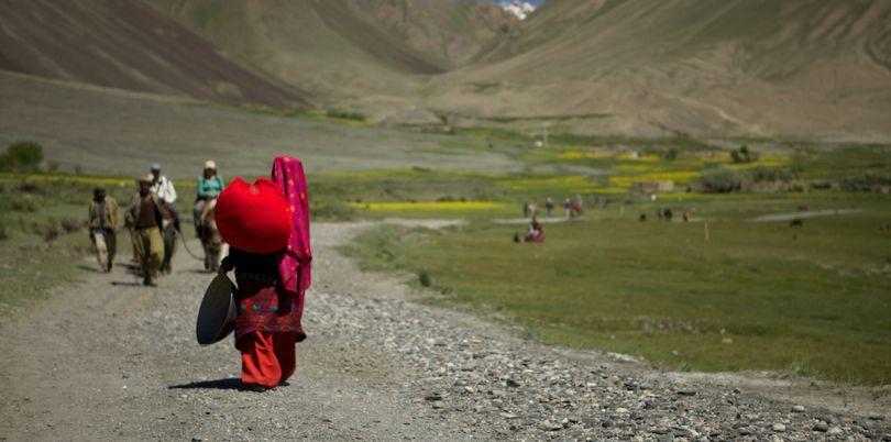 Woman walking away in the Wakhan Corridor, in Afghanistan