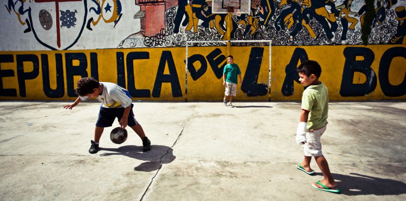 Children playing football in the streets of La Boca, Argentina