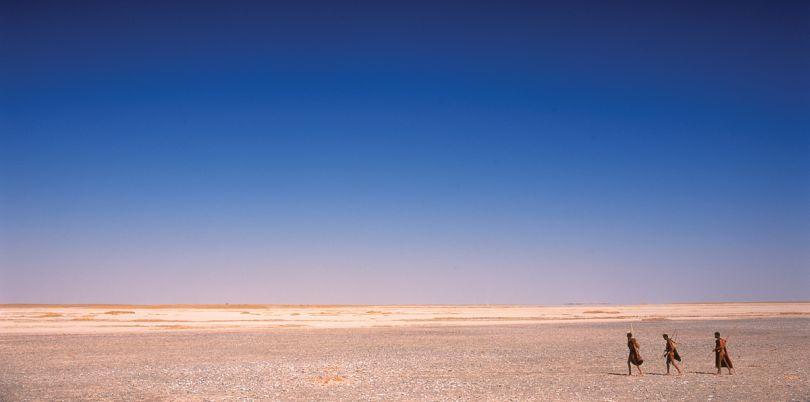 Bushmen crossing the Kalahari desert, Botswana