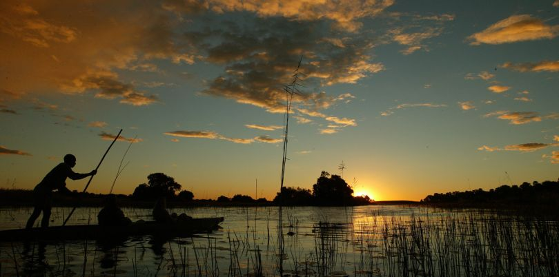 Sunset safari in canoe in the Okavango, Botswana