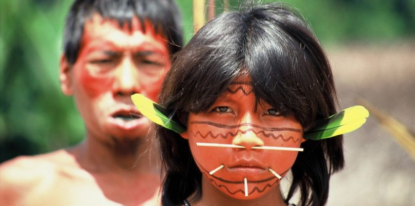 Indigenous people of a Brazilian tribe with face accessoires