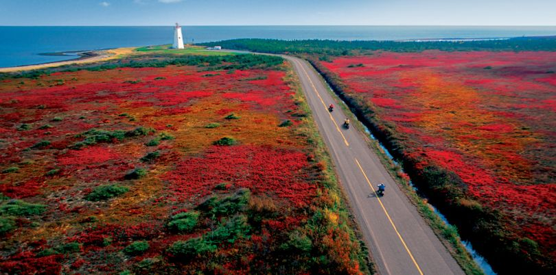 Colourful Canadian landscape with lighthouse at the coast