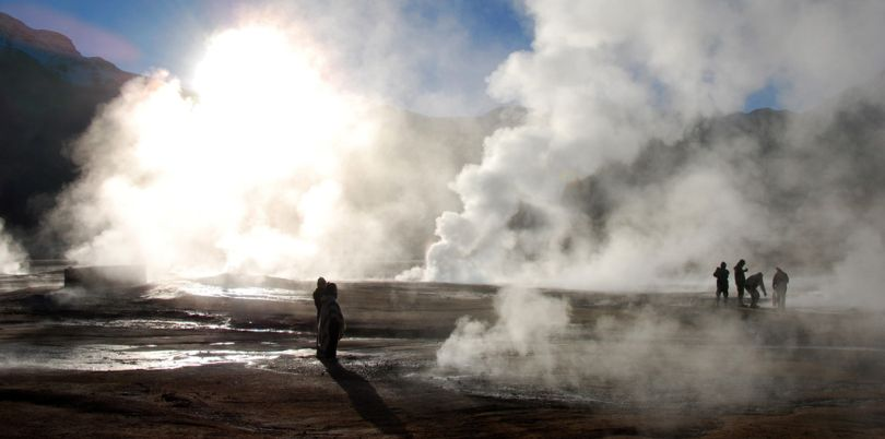 People at steaming hot springs in the Atacama desert Chile