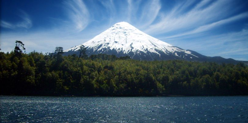 Osorno volcano with snowy peak view across lake in Chile