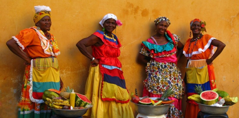 Colombian women with fruit baskets