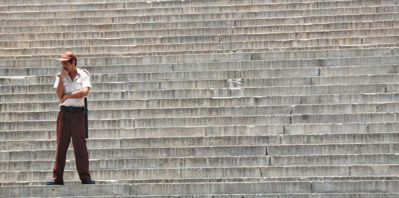Man standing on steps in Cuba