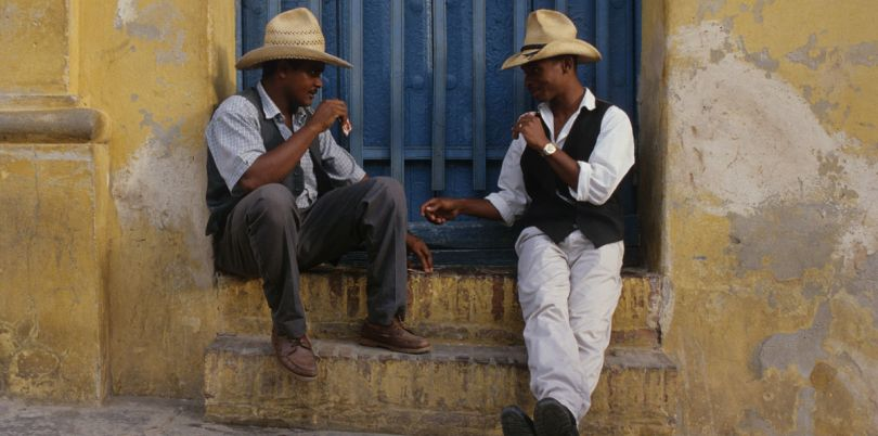 Two Cuban men chatting in a doorway