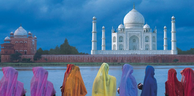 Indian women looking over the Taj Mahal, Agra, India