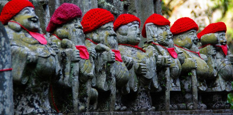 Statues in Japan with red hats on, Japan