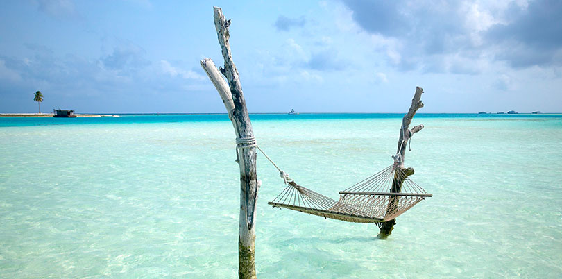 Maldives hammock in the ocean crystal clear water