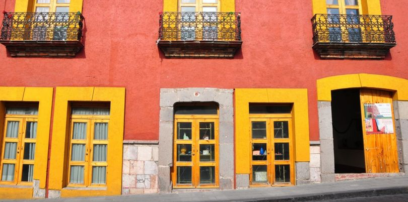 Street view of orange and yellow buildings, Mexico