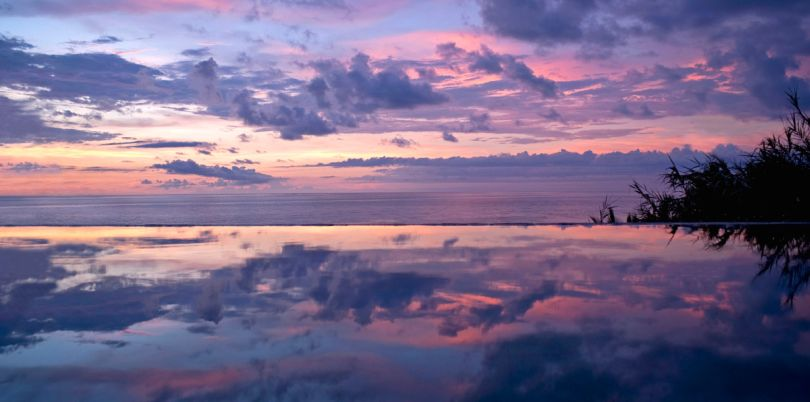 Sunset over an infinity pool in Imanta Resort, Mexico