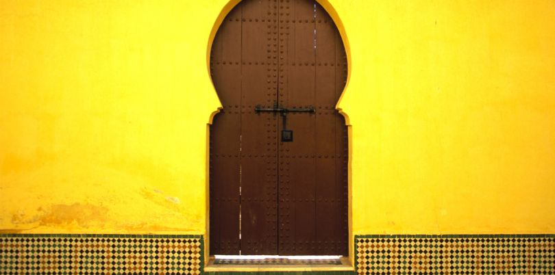 Yellow building with a brown door, Morocco