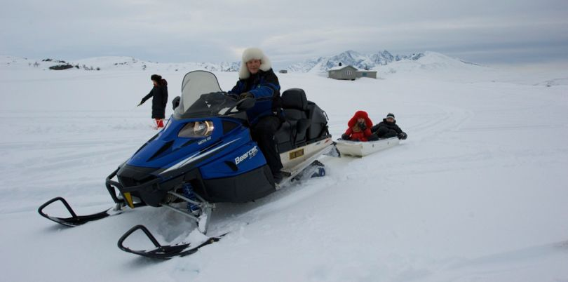 Snow mobile ride to go ice fishing, Norway