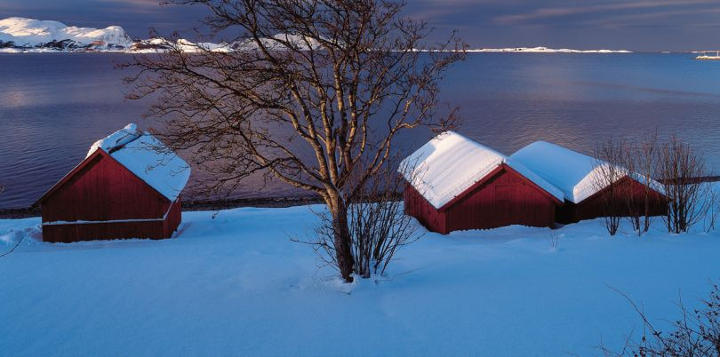 Houses overlooking the sea in the snow, Norway