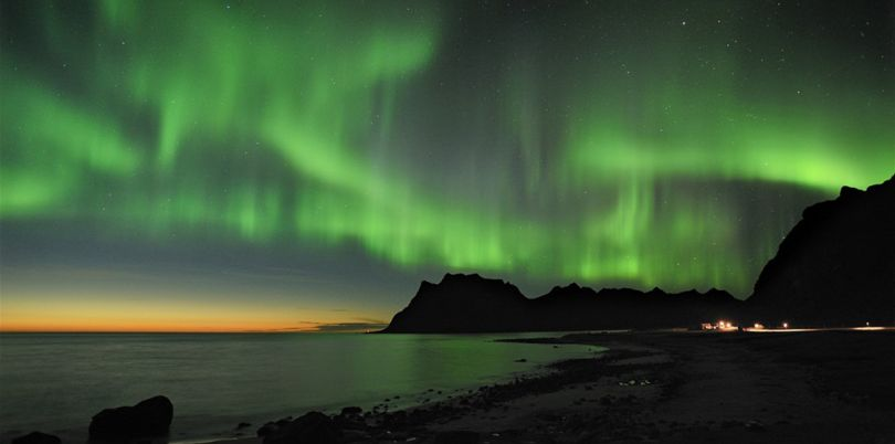 Green northern lights over the sea, Norway