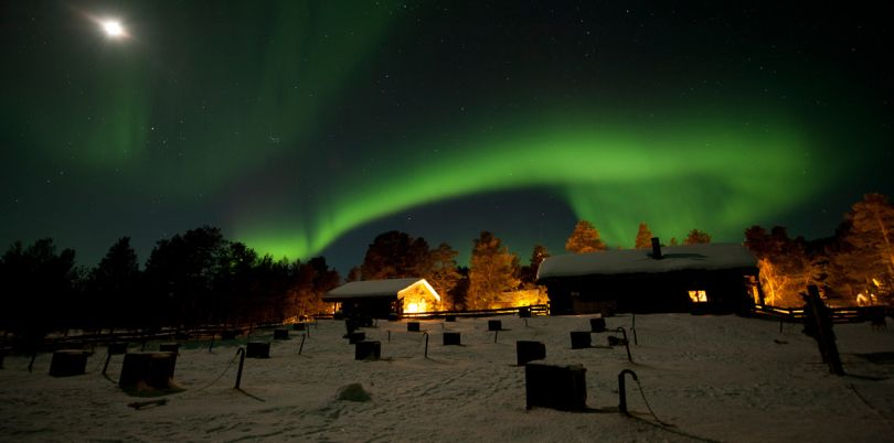 Green northern lights over a village, Norway