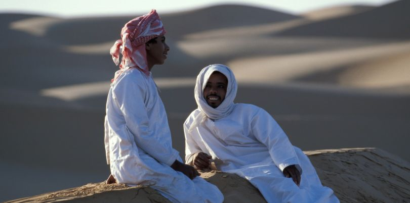 Two local men sitting on the dunes, Oman
