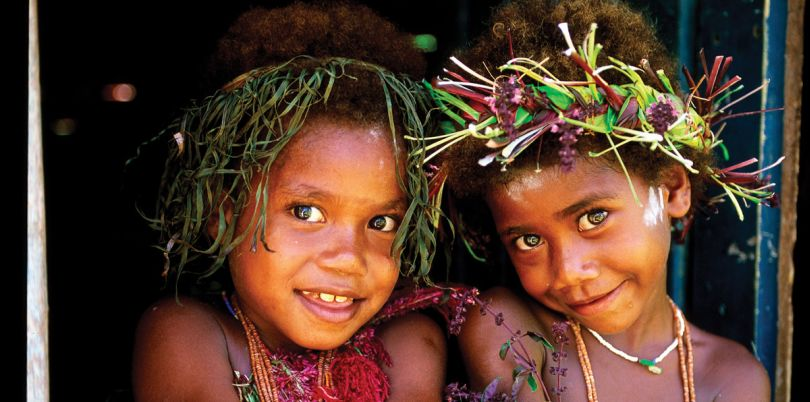 Two young girls from Papua New Guinea with hair accessories