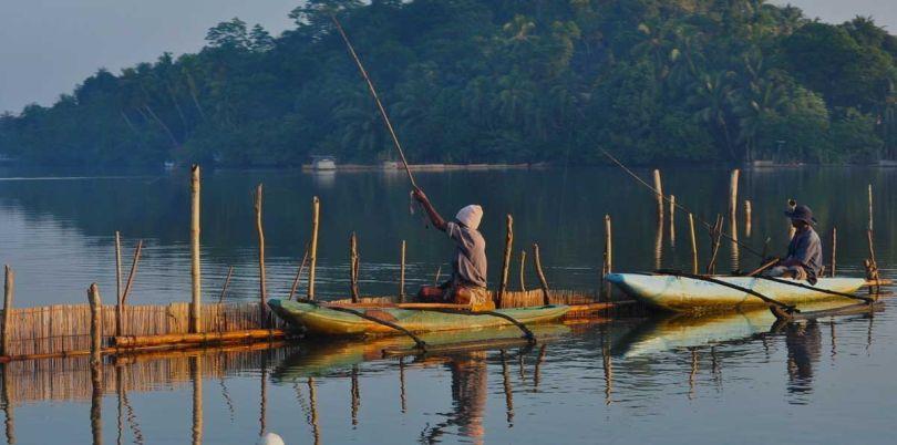 Fishermen in canoes in Sri Lanka