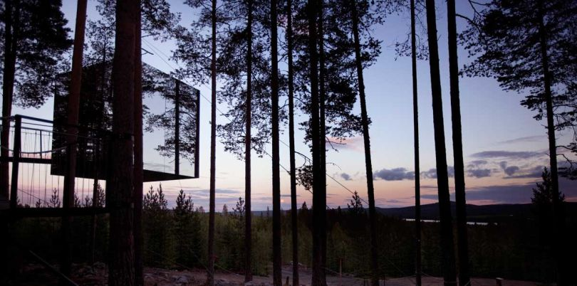 Mirror cube exterior at dusk, the Tree Hotel, Sweden