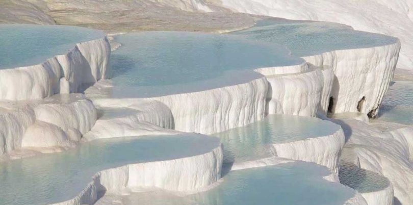 Travertine terraces of Pamukkale Turkey relax in the Greek-Roman spa city Hierapolis