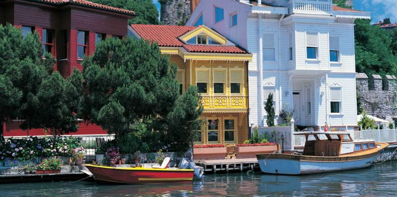 Colourful houses with landed boats at the Bosphorus in Turkey