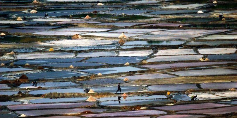 Person walking across the salt planes in Uganda